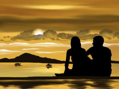 мужчина и женщина сидят на берегу